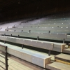 Most seats in the arena have wooden backs for our guests' comfort