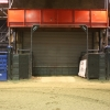 Large roll up door under the pressbox leads to stock pens